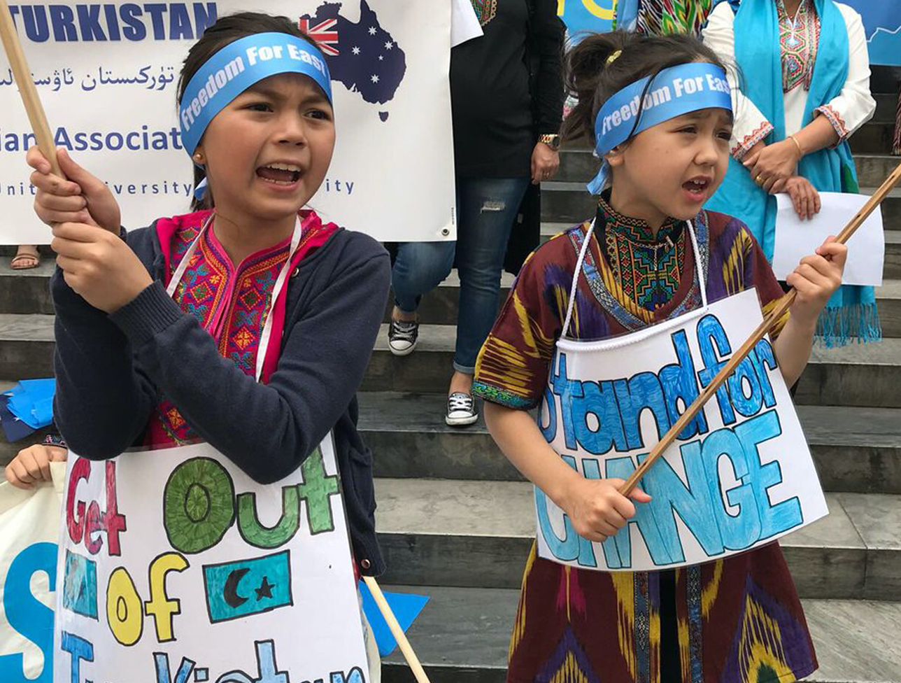 This is an image of Uyghur children protesting